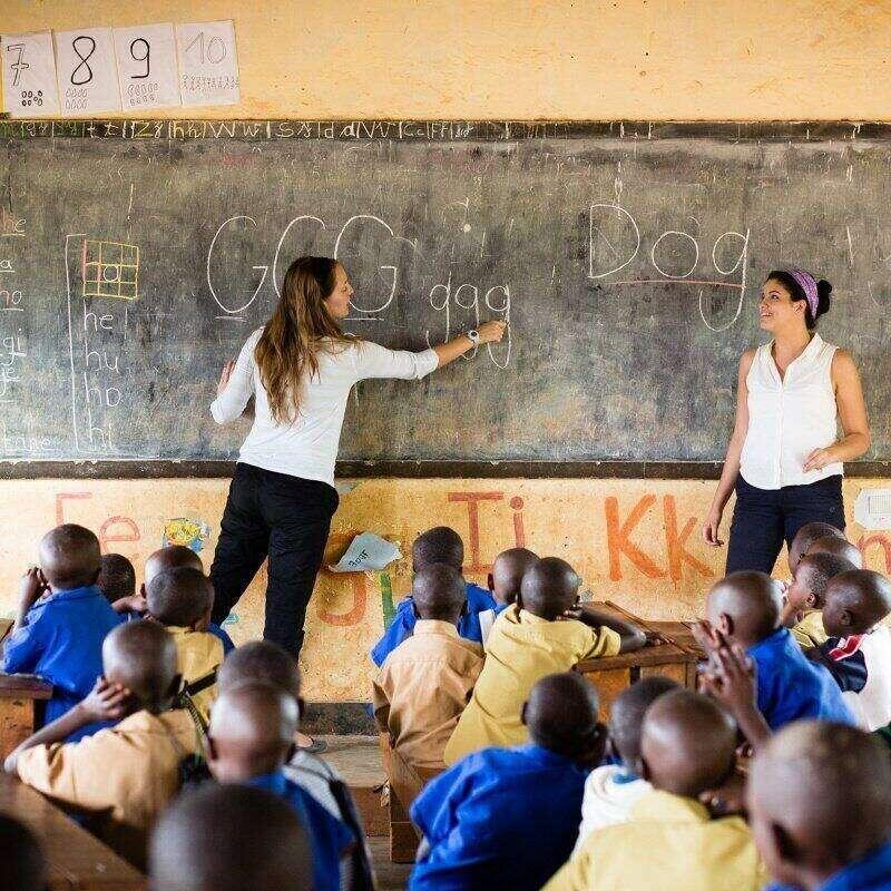 Rollins Education students give a lecture to children in Rwanda.