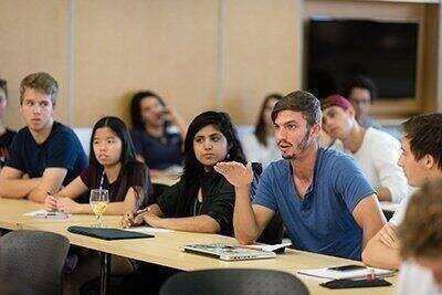 Students in a discussion during a lecture.