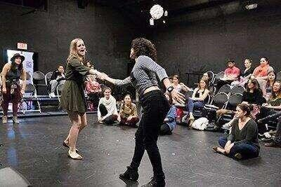 Students practice improv together in the Black Box Theatre.