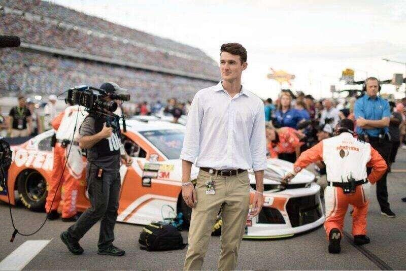 A Rollins alumn working at a NASCAR event.