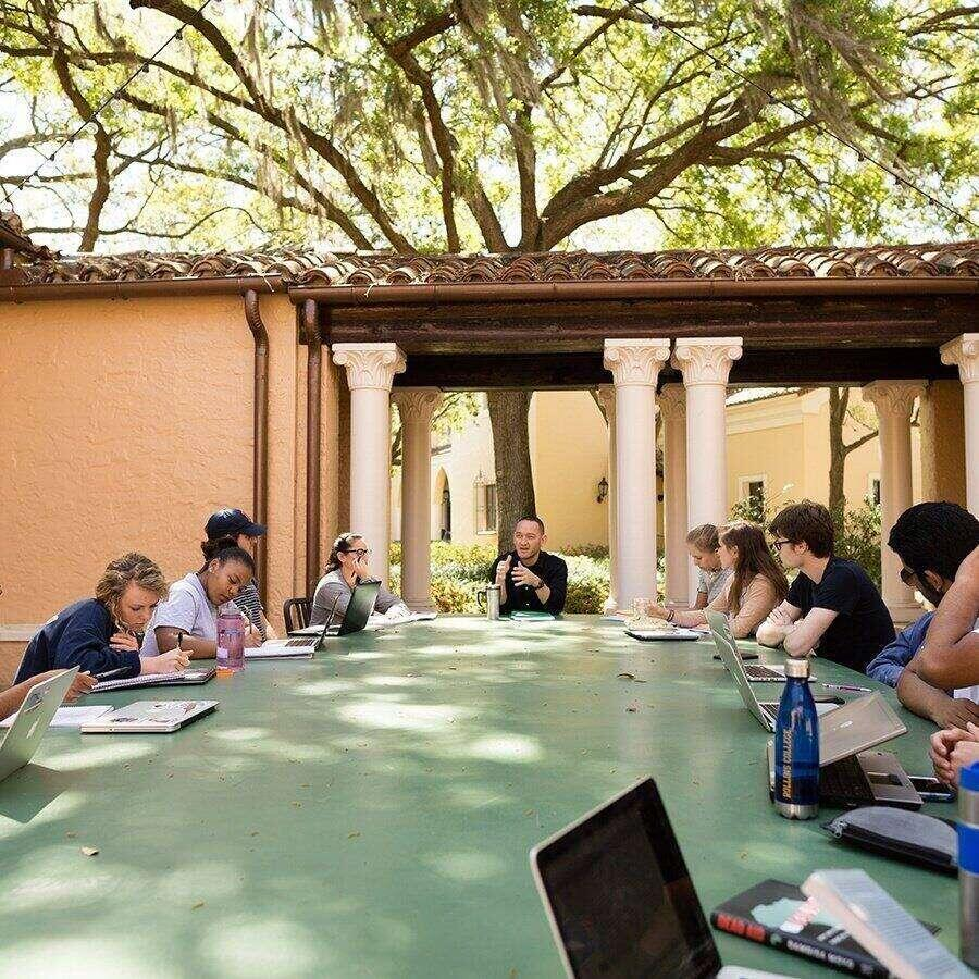 Rollins political science students hold class outside.