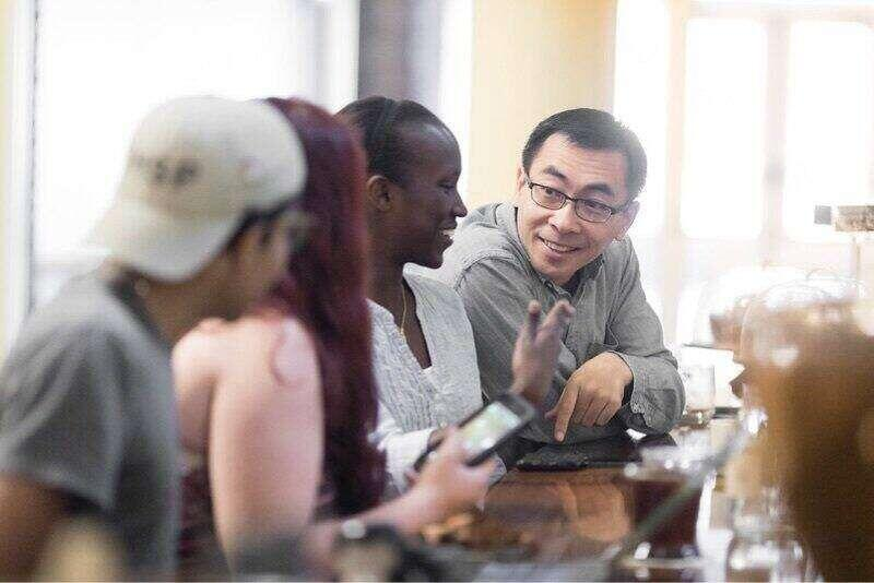Professor Dan Chong with students at a Winter Park coffee shop.