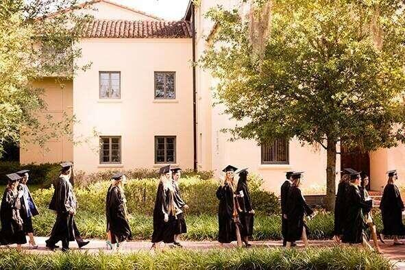 Students walking across campus during commencement.
