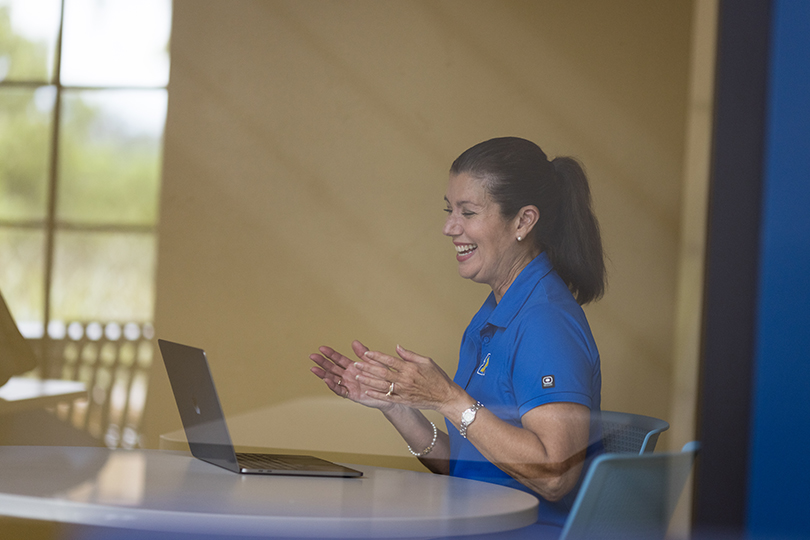 A Hamilton Holt School counselor video chats with a prospective student