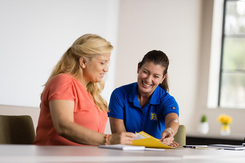 A Rollins counselor meets one on one with a prospective student.